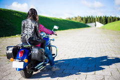 Back view of couple going to travel on motorbike Royalty Free Stock Image