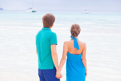 Back view of couple holding hands at a tropical Royalty Free Stock Images