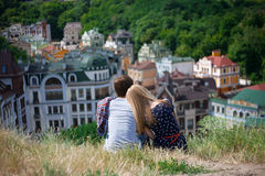 Back view of couple hugging and looking the city Royalty Free Stock Photo