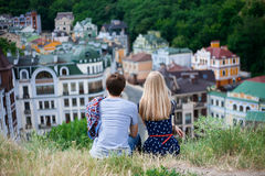 Back view of couple hugging and looking the city Stock Photos