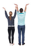 Back view couple  looking at wall and Holds  hand up. Stock Photos