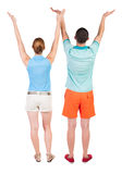 Back view couple  looking at wall and Holds  hand up. Royalty Free Stock Images