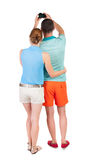 Back view of couple photographing. Stock Photo