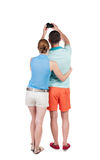 Back view of couple photographing. Stock Image
