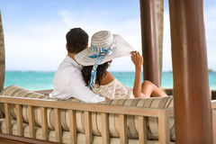 Back view of couple relaxing on holiday Stock Photography