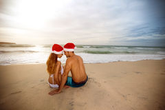 Back view of couple with Santa hats Royalty Free Stock Photography