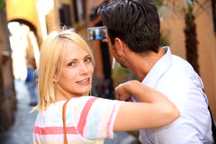 Back view of couple standing in old street of Rome Royalty Free Stock Photo
