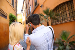 Back view of couple taking pictures of Rome Royalty Free Stock Photos