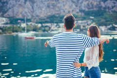 Back view of a couple of tourists sightseeing in a travel destination. With a port Royalty Free Stock Photo