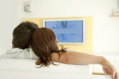 Back View of Couple Watchign TV Stock Photography