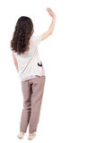 Back view of curly woman welcomes. Stock Photos