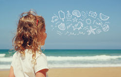 Back view of cute girl imagine boat, birds and sun with set of infographics over beach and sea background Stock Photo