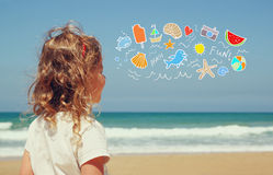 Back view of cute girl imagine boat, birds and sun with set of infographics over beach and sea background Stock Image