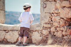 Back view of cute little boy outdoors in city Royalty Free Stock Photo