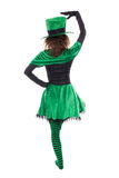 Back view from a dancing leprechaun girl, isolated on white, con Stock Images