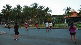 Back View of Dancing Peoples on Group Training in Public City Park