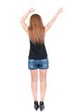 Back view of dancing young beautiful  redhead woman. Stock Photo