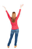 Back view of dancing young beautiful  woman. Royalty Free Stock Photo
