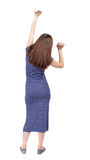 Back view of dancing young beautiful  woman. Royalty Free Stock Images