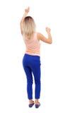 Back view of dancing young beautiful  woman. girl  watching. Royalty Free Stock Image