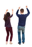 Back view of dancing young couple. Dance party. Back view of dancing young couple(men and women). Dance party. girls and guys teens dance, enjoy and express royalty free stock photography