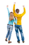 Back view of dancing young couple. (men and women). Dance party. girls and guys teens dance, enjoy and express positive emotions and having fun. backside view of royalty free stock image