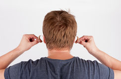 Back view of a deaf man's head and hands inserting his hearing a Royalty Free Stock Images