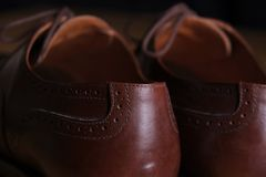 Back view detail of a pair of classic brown leather Brogue shoes with laces Stock Photography