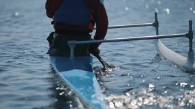 Back view of Disabled athlete using paddle in a canoe. Rowing, canoeing, paddling. Training. Kayaking. paraolympic sport. Close up Disabled athlete using paddle stock video