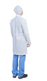 Back view of doctor in robe. Standing young guy. Royalty Free Stock Photography