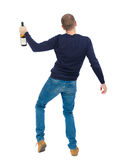 Back view of drunk man with  bottle  wine. drinking young guy Royalty Free Stock Photos
