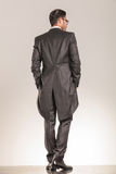 Back view of a elegant business man walking stock image