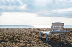 Back view empty chaise lounge before ocean. Chaise lounges on the beach of the sea stock images