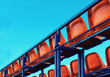 Back view of empty red seats in a stadium. Empty red seats in a stadium. Back view Stock Images