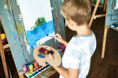 Cute Little Artist Focused on Work Royalty Free Stock Images