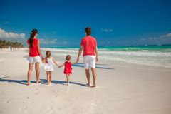 Back view family of four on beach vacation Royalty Free Stock Photo
