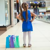 Back view of fashion girl with packages in Stock Photo