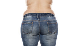 Fat woman. Back view of a fat woman in jeans on white background stock images
