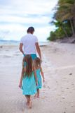 Back view of father and his two little daughters Royalty Free Stock Images