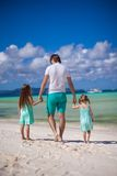 Back view of father and his two little daughters Royalty Free Stock Photo