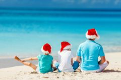 Father with kids at beach on Christmas Stock Photos