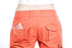 Back view of female buttocks in orange pants Stock Photo
