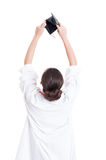 Back view of female doctor holding her wallet Royalty Free Stock Images