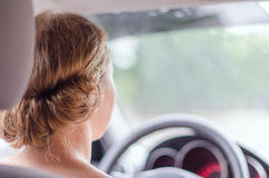 Back view of female driver Stock Photo