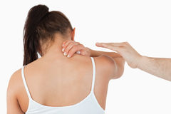 Back view of female having pain in her neck Royalty Free Stock Images