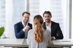 Back view of female job applicant interview in office royalty free stock photography
