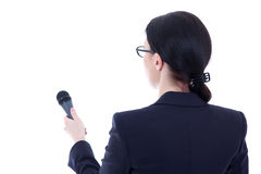 Back view of female journalist with microphone isolated on white. Background Royalty Free Stock Image