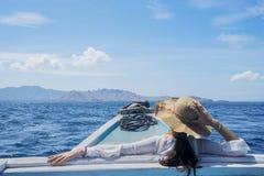 Female tourist enjoying a beautiful seascape royalty free stock photo