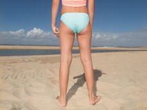 Back view of fit young woman in green bikini Royalty Free Stock Photography