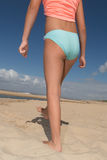 Back view of fit young woman in green bikini Royalty Free Stock Image
